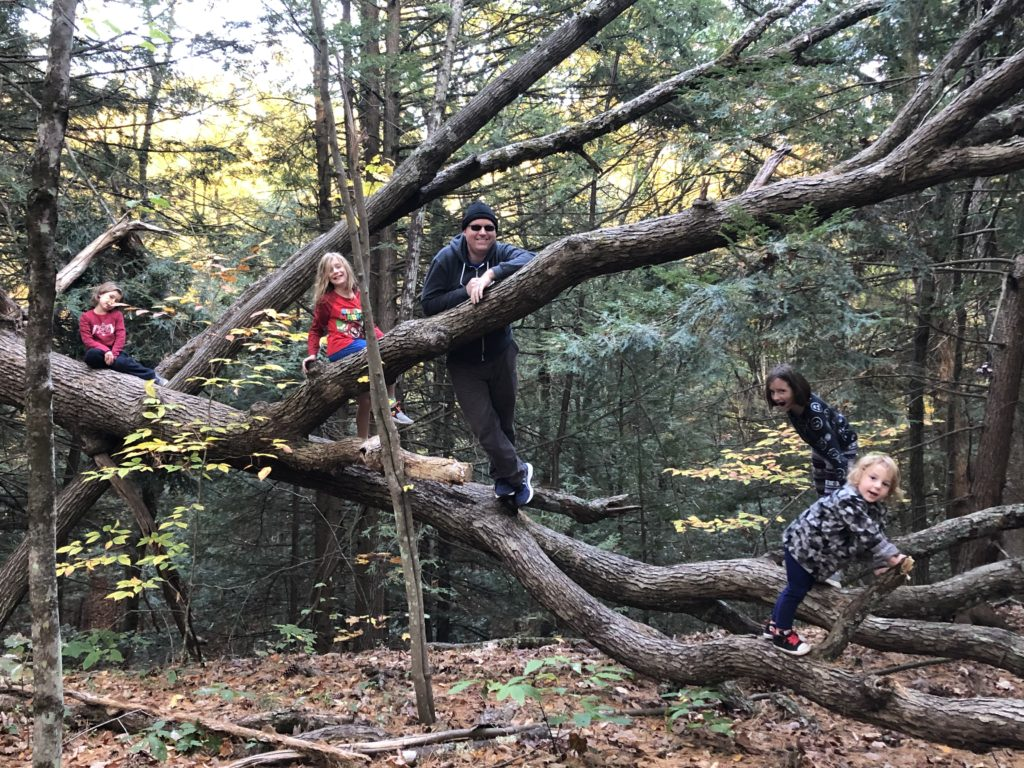 Ainsley, Dillon, Kevin, Rayleigh, and Grayson all climbed on this massive downed tree.