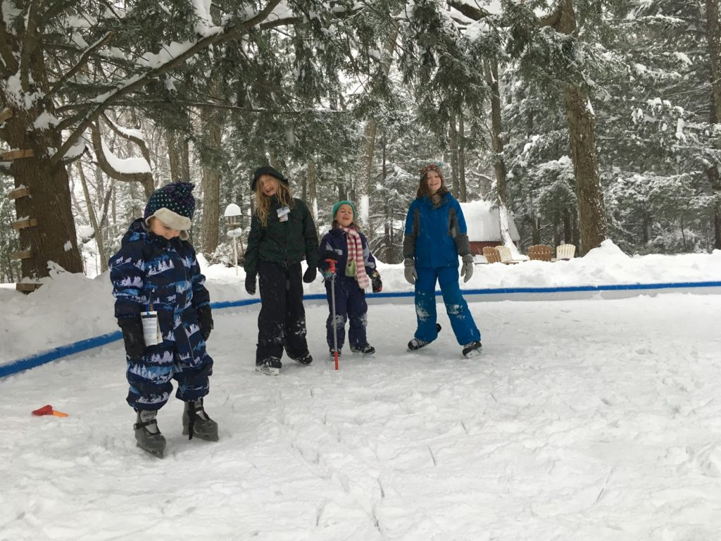A photo of Grayson, Dillon, Ainsley, and Rayleigh skating on the rink for the first time.